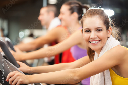 Sticker Portrait of a smiling woman in a gym