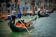 Gondola in canal in Venice