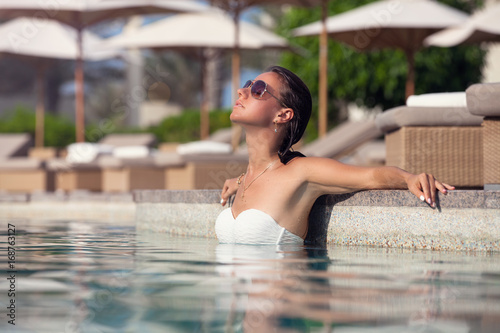 Young woman enjoying sun at  poolside