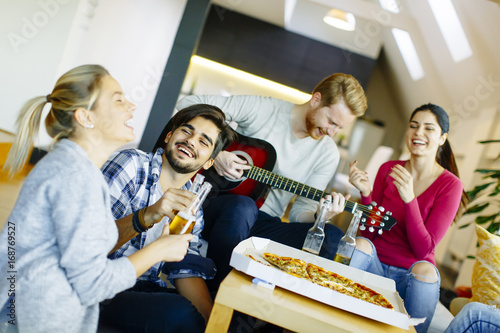 Group of young people having pizza party