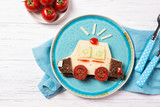 Funny sandwich with cheese and vegetables in a shape of police car, meal for kids idea, top view - 168771566
