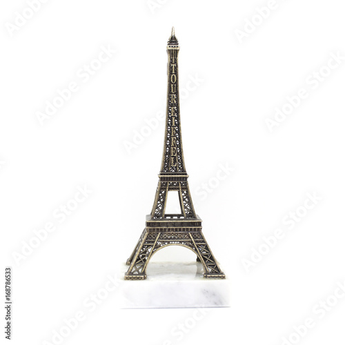 Fotobehang Eiffeltoren Paris Eiffel tower miniature on the marble stand isolated on white background