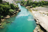 Looking south from the Old Bridge (Stari Most) over the River Neretva, Mostar, Bosnia and Herzegovina. - 168803947