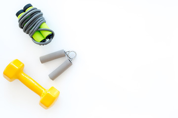 Equipment for fitness. Jump rope, dumbbells and expander on white background top view copyspace © 9dreamstudio