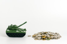 Green Toy Tank Crossing Over Stack Of Coins    Concept Of Expense And Cost Of War Sticker