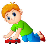 Little boy playing a toy car
