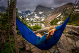 Woman relaxes on a hammock lake Isabelle Colorado - 168822114