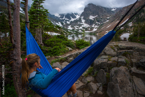Woman relaxes on a hammock lake Isabelle Colorado