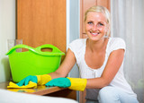 Woman in rubber gloves cleaning indoors . - 168838506