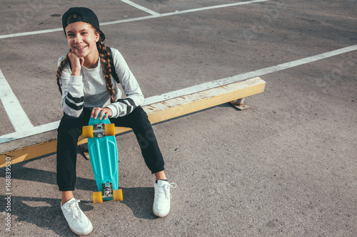 Fotobehang Skateboard Pre teen skater on the city street
