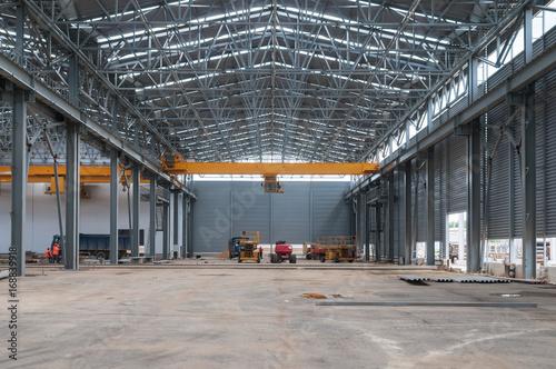 Foto op Canvas Oude verlaten gebouwen Factory warehouse overhead crane