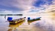 A fisherman boat at seashore with amazing sunrise at Jubakar Pantai, Tumpat, Kelantan, Malaysia.