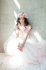Beautiful Woman in Pink Dress and Rose Flower Wreath, Wavy Hairstyle and Makeup