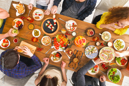 People eat healthy meals at served table dinner party