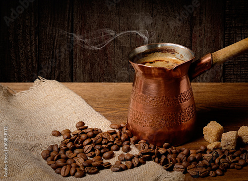 Sticker Turk with hot coffee on wooden background