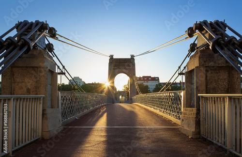 mata magnetyczna Summer sunrise at the monumental Passerelle du College bridge over Rhone river in Lyon, France.