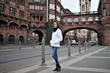 A tourist girl outdoors against the backdrop of the attractions of the city of Frankfurt am Main, Germany
