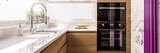 Designed kitchen with white glossy countertop