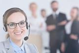 Businesswoman wearing headset