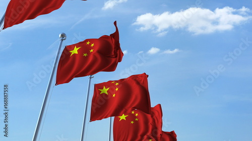 Row of waving flags of China agaist blue sky, 3D rendering