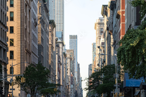 Foto op Aluminium New York View down Fifth Avenue in Manhattan, New York City with historic buildings lining both sides of the street in NYC