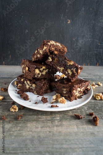 walnut brownies stacked on plate Poster