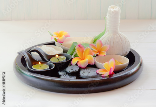 Thai massage, candle aromatherapy in Spa set on the white table, on soft background, in vintage color. © Superheang168