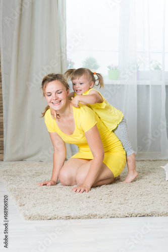 Mom and daughter of two years playing