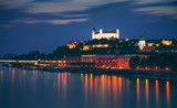 Castle of Bratislava, Slovakia at Night as Seen from a Bridge over Danube River Towards Old Town of Bratislava.