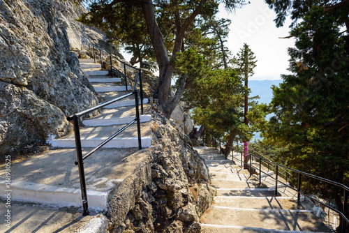 Poster Road with 300 steps to Tsampika church on Rhodes town