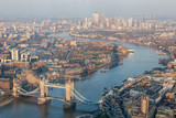 a view of Thames river and London at sunset with red sky and air pollution with Tower bridge