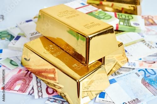 Gold bar and euro money. Financial concept