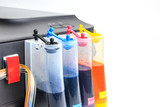 Setting up modified ink tank for inkjet printer. Printer color ink tank beside isolated on white background - 168945132