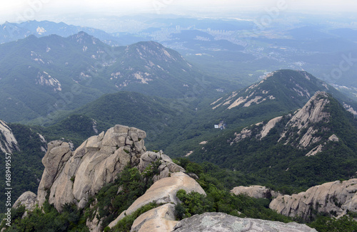 Rocky terrain in Bukhansan National Park, a popular place to climb and hike, Seo Poster