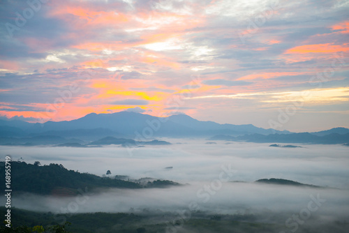 Foto op Plexiglas Donkergrijs Landscape of misty mountain forest covered hills at khao khai nui