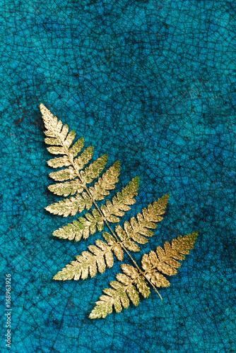 gold fern leaves