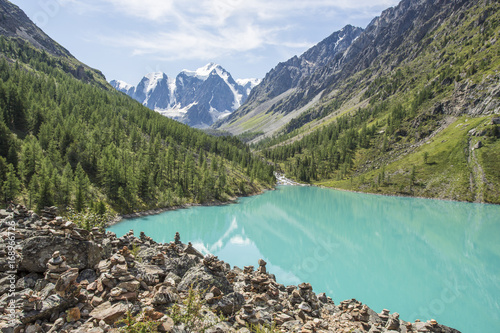 View of the mountains with reflection in the blue lake.