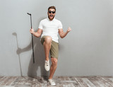 Full length image of a Happy Screaming golfer in sunglasses - 168971199