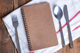Blank recipe book on wooden table - 168977591