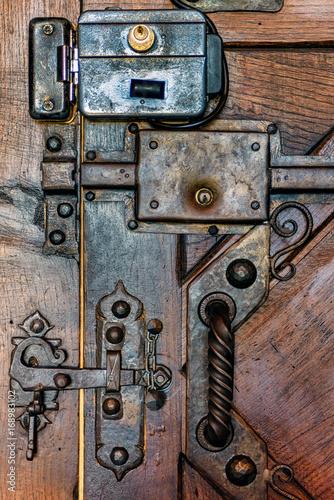 Vintage Metal Door Lock On Wooden Door