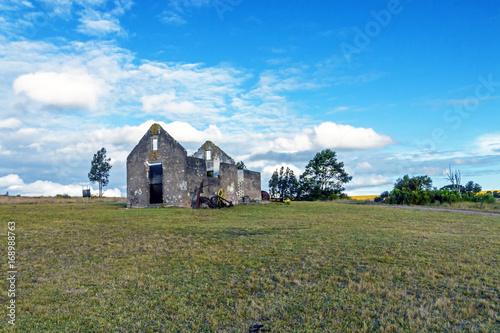 Rural Old  Derelect Farm Building on Dry Winter Landscape