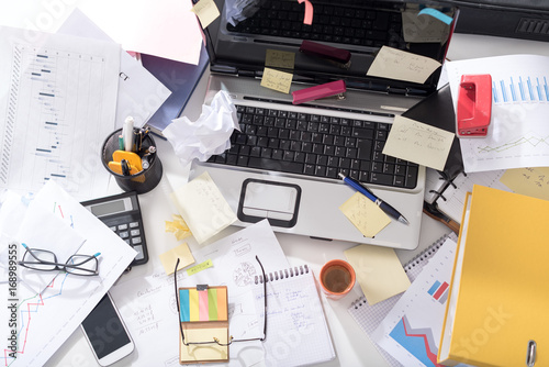 Foto Murales Messy and cluttered desk