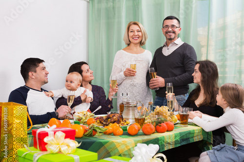 Big happy positive family sitting at holiday table