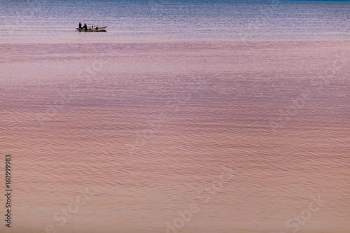Fish boat on the horizon