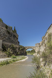 roman bridge and old town in vaison la romaine
