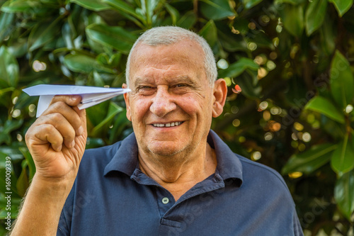 Elder playing with a paper airplane