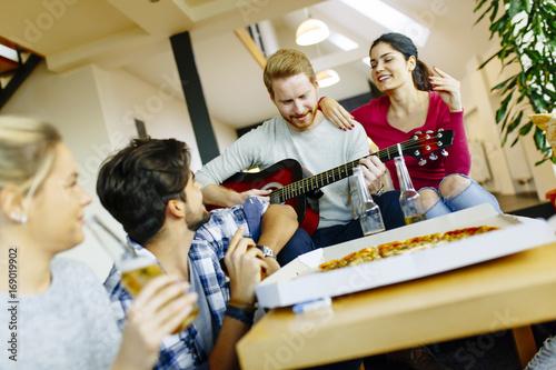 Fotobehang Muziek Group of young people having pizza party