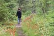 Boy walks away on hiking trail