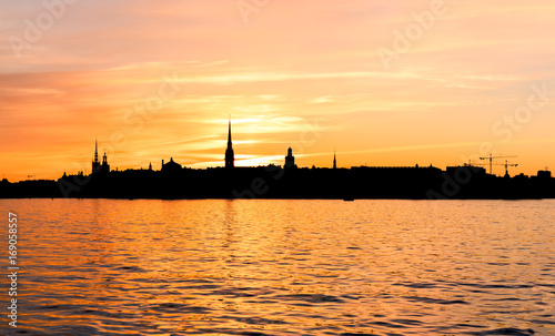Aluminium Stockholm Skyline of the old town in Stockholm as a silhouette during sunset.