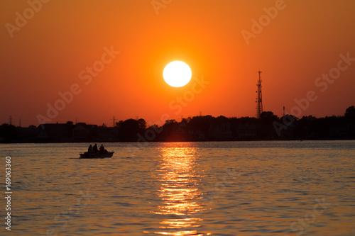 In de dag Oranje eclat Sunset from the boat on the ocean
